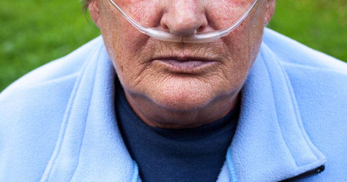 Senior on portable oxygen